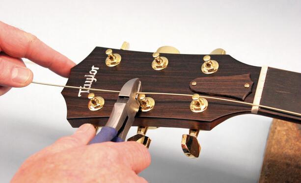 changing steel guitar strings taylor guitars. Black Bedroom Furniture Sets. Home Design Ideas